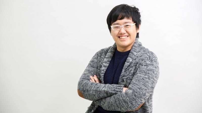 """정상영 UNIST 전기전자컴퓨터공학부 석·박사통합과정 연구원이 활짝 웃고 있다. 그는 """"UNIST는 기회가 많은 학교""""라며 """"어떤 선택을 하느냐에 따라 크게 성장할 수 있는 곳""""이라고 말했다."""
