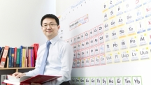Prof. Yoon-Seok Oh (School of Natural Science) poses for a portrait in his office at UNIST.