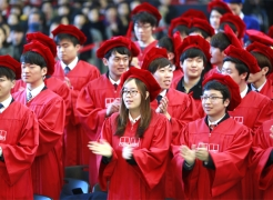 Graduates at the 2015 Commencement Ceremony, wearing academic regalia.