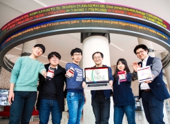 The SIMAPLE Startup team is posing for a group photo in front of LED Stock Ticker Board at Business Administration Bldg., UNIST. From left are Sung Joe Kim, YeongSeok Kim, SeungHoon Lee, KyungHoon Kim, SunHwa Lee, and Han Lee.