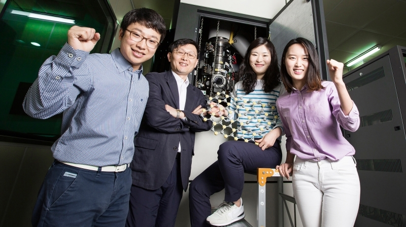 Prof. Zonghoon Lee's research team is posing for a group photo in front of the Advanced Transmission Electron Microscopy at UNIST. From left are Jongyeong Lee, Prof. Lee, GyeongHee Ryu, and HyoJu Park.