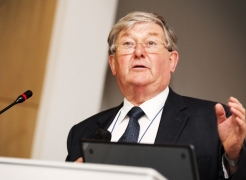 Prof. David Philips CBE (Past President of the Royal Society of Chemistry), delivering the welcome remark at the symposium on August 12, 2015.