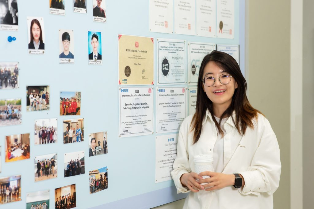 Hei In Yoon, posing for a portrait in front of her lab at UNIST.
