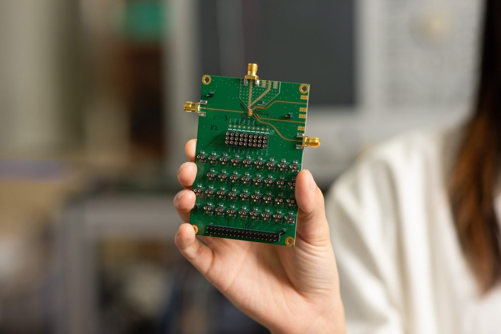 It is the job of a semiconductor designer to draw circuitry on a chip that is smaller than a fingernail to drive electronic devices. In the photo, the semiconductor chip is located in the middle of where the golden lines are merged.