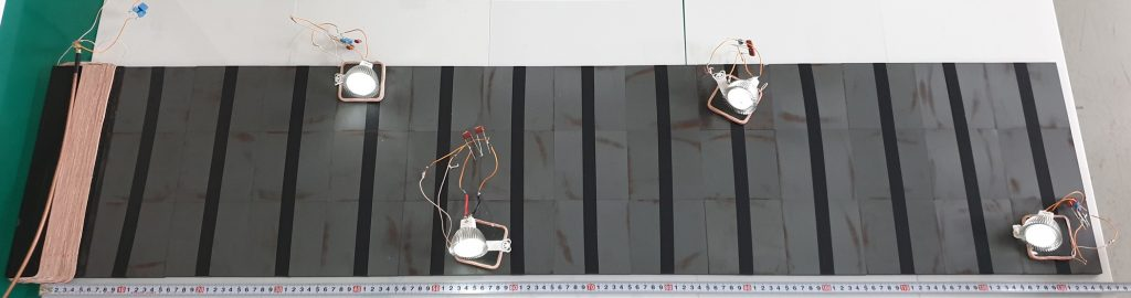 Figure 1. Four LED bulbs are lighted with the proposed WPT system. The maximum distance of a bulb from the Tx coil is 130 cm.