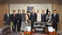 Pictured from left are Director Jin-Hyouk Im (Center for Teaching and Learning), Prof. Byeong-Su Kim (Department of Chemistry), Prof. Tae-Hyuk Kwon (School of Natural Science), Prof. Jae Yon Lee (Division of General Studies), Jinsook Choi (Division of General Studies), President Moo Je Cho, Bradley S. Tartar (Division of General Studies), Sang Young Lee (School of Energy and Chemical Engineering), Jin Young Kim (School of Energy and Chemical Engineering), Kwanyoung Seo (School of Energy and Chemical Engineering).