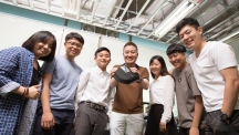 Prof. Jeong and his team are posing for a group photo, while holding