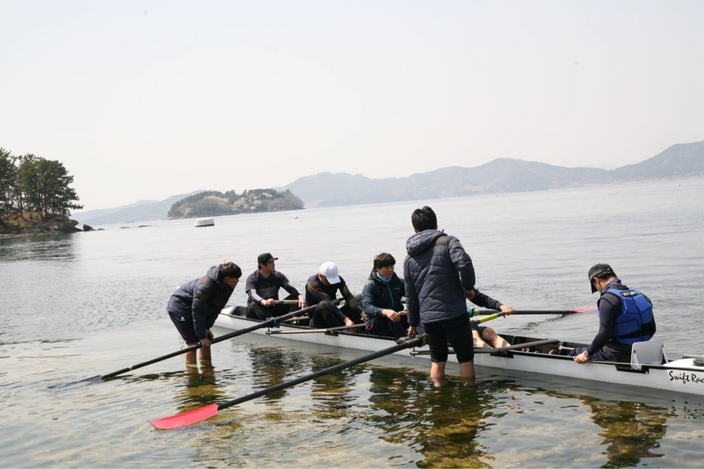 The UNIST rowing team Changwon Okpo Bay, as they prepare for their race on Saturday, April 7, 2018.